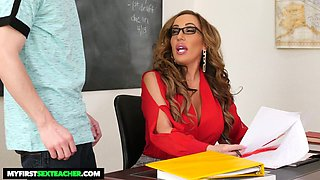 Bitchy teacher Richelle Ryan fucks one of her students right on the table
