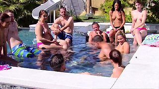 Chubby couple joins other swingers in the pool for hot fun