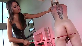 Corset mistress with big boobs whips male slave