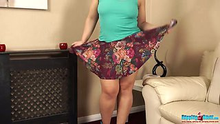 All alone a bit plump MILF Ashley Rider plays with her own boobies