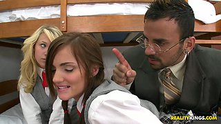 Poor students Teagan Summers and Lily Carter give double blowjob to their teacher