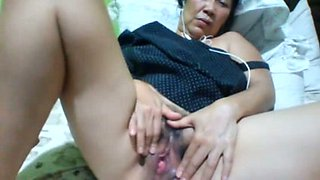 Filipina fatty with dark hair and saggy huge boobs masturbates herself