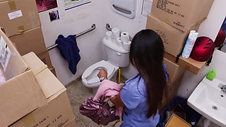 Camera hidden in toilet films her pussy while she stuffs it with pants!