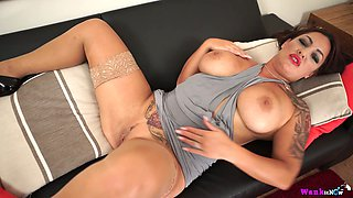 Awesome tattooed big breasted MILF Roxy R teases her wet meaty pussy