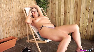 Sex-hungry BBW Lou Pierce is pleasing herself on a beach chair