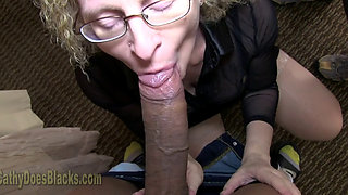 Mature blonde fucking a big black cock