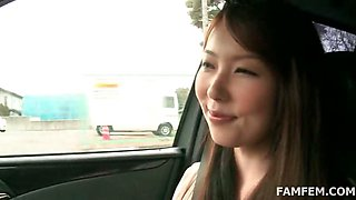Asian hottie shows sexy assets in the car