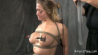 Clamps on appetizing tits and nylon on her head