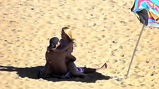 Voyeur finds a horny amateur couple having sex on the beach