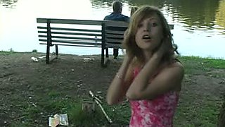 Marvelous skinny white girl in pink dress flashes her petite booty in the park