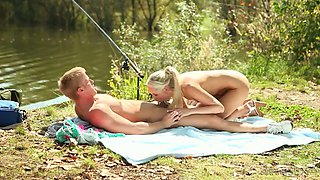 Sensual blonde with perky breasts is having sex by the pool