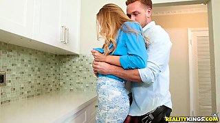 blonde milf deepthroats a guy's dick in the kitchen