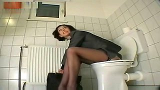 My personal secretary masturbates with dildo at the restroom