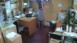 Hidden cam brunette in office