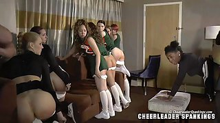 Group of cheerleaders spanked