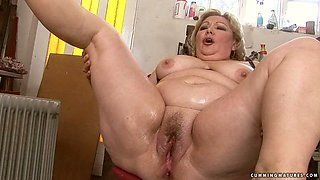 old broad is forced to cum by a dude that keeps inserting toys in her gash