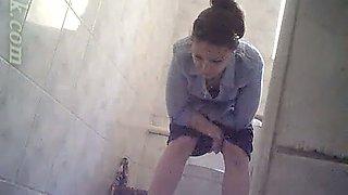 Cute brunette white girl in tight short pisses in the toilet