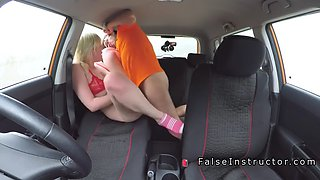 blonde driving student takes cock in car