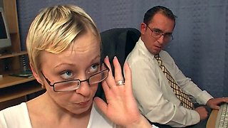 Short haired secretary Petra kneels down to give blowjobs to her co-workers
