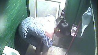 Brunette lovely white stranger filmed from above in the toilet room
