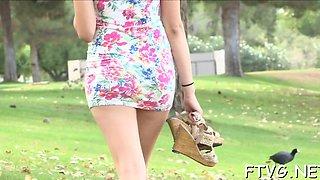 Busty slut widens legs wide inserting cucumber into vagina