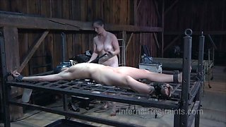 Good looking mistress uses pee on her slave's face over the towel