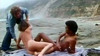 Cute and sexy classic white lady on the beach shared with a black man