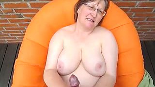 Chubby nerdy short haired nympho with huge boobies wanks dick
