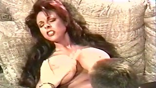 Magnificent and slutty redhead milf with plastic huge boobies receives cunnilingus