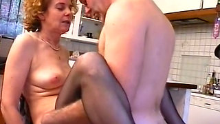 Filthy blonde French cougar in the kitchen having sex