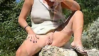 Busty mature lady flaunts her amazing curves in the outdoors