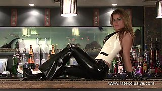 Stunning barwoman in sexy latex stuff exposes her alluring cleverage