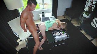 Clumsy secretary bending over her boss' desk to keep job