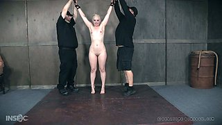 Curvy blond bitch is suspended and punished in the dark basement