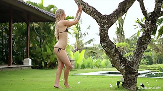 Sex goddess in an inviting bikini caresses her tone skin in a captivating tape