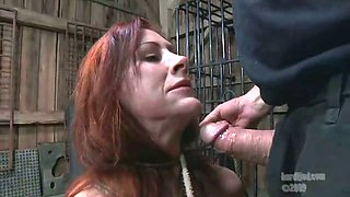 Tied up and restrained ginger slut gets her cunt toyed