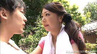 Japanese housewife aroused by the way he gropes her nipples
