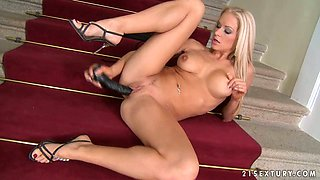 Luxurious Stacy Silver plays with her pussy on the stairs