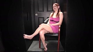She Sits With Her Legs Crossed And Bounces Her Bare-feet