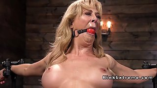 toned busty blonde punished in device