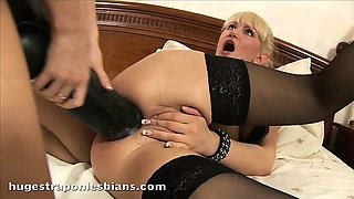 Rocky stretches Anita\'s asshole with a monster strapon