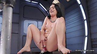 brunette enjoys anal fucking machine