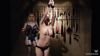 Blonde lesbian mistress gives her chubby slave a hardcore abuse