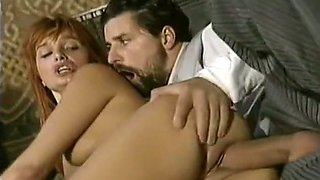 Mesmerizing and passionate redhead white chick on the bed
