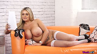 Smoking hot milf with huge adorable boobs Katie T is posing on the couch