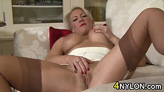 Busty Blonde MILF In Nylons Masturbates