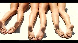 Three slender teens in sexy bikinis expose their lovely feet