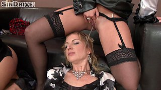 Lesbians in sexy and expensive clothes piss on each other