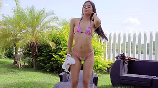 Stunning teen model Karin Torres is playing with her charming pussy in the garden