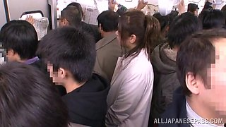 Japanese hottie enjoys banging with a stranger in a train